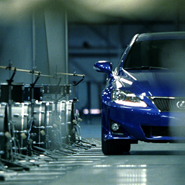 A Lexus IS sedan plays music in a new TV spot