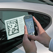 Consumer using Microsoft Tag to scan a Porsche