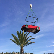 Jaguar F-Type suspended by crane