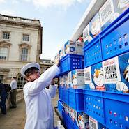 Anya Hindmarch milkman delivering Fashion Flakes