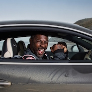 Idris Elba in a Bentley