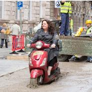 "Scene of Melissa McCarthy outside a scene from ""Spy"""