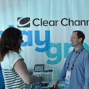 Clear Channel Outdoor CMO Dan Levi in conversation with a visitor at Clear Channel Outdoor's exhibit at Cannes Lions in Cannes, France