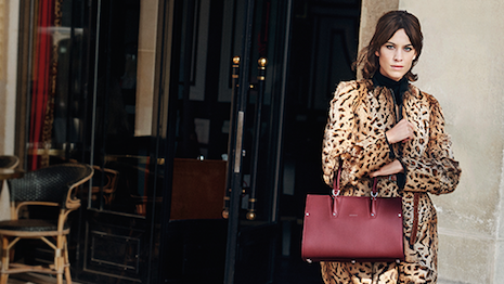 Longchamp's Paris Premier handbag modeled by Alexa Chung