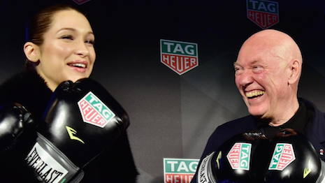 Bella Hadid with Tag Heuer CEO Jean-Claude Biver