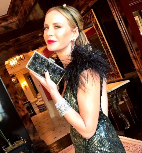 Dee Ocleppo Hilfiger holding Judith Leiber's Paedras in gold and resin bag
