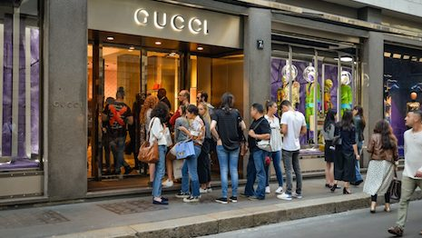 Launching WeChat mini program platform, building advertising campaigns, and starring KOLs are three strategies Gucci uses to promote sales in China. Photo credit: Shutterstock