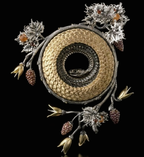 Lin Stanionis, Awakening, 2011, featuring 18K gold, sterling, garnets, enamel, snake skeleton. Collection: Jon Blumb