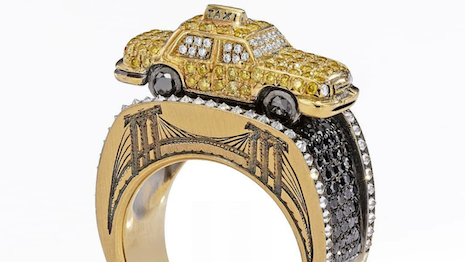 Wendy Brandes, Maneater Ring: NYC Taxi and Passenger, featuring 92 yellow diamonds, totaling 0.59 carat, 92 white diamonds, totaling 0.46 carat, 130 black diamonds, totaling 1.04 carats, two small rubies, and 23 grams of 18K gold. Made in New York. Image credit: Wendy Brandes