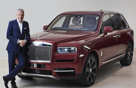 Rolls-Royce Motor Cars CEO Torsten Müller-Ötvös posing next to the new Cullinan sports utility vehicle. Image courtesy of Rolls-Royce Motor Cars