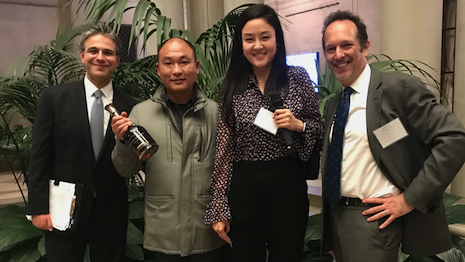 Madison Avenue Business Improvement CEO Matthew Bauer with Chinese tour guides at the Frick Collection on Fifth Avenue in New York. David Becker, CEO of Attract China, is at the opposite end