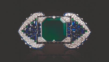 An Art Deco emerald, sapphire and diamond belt-buckle brooch by Cartier fetched $1.545 million (estimate $500,000 to $700,000) in Christie's Maharajas & Mughal Magnificence auction held in New York June 19. Image credit: Christie's