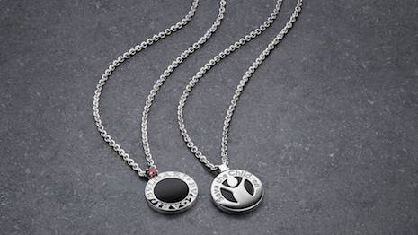 Bulgari's silver and onyx pendant set with a red ruby, a portion of whose sales go to the Save the Children charity. Image courtesy of Bulgari