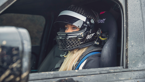 "Stunt driver Jess Hawkins at work during the filming of ""No Time to Die,"" the 25th official James Bond movie. Image courtesy of Land Rover"