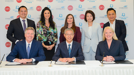 Signing ceremony for the tripartite deal: from left to right, DFS Group's Ed Brennan, Genting Cruise Lines' Kent Zhu and Starboard Cruise Services' Lisa Bauer. Image courtesy of Starboard Cruise Services and DFS Group