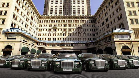 This is Hong Kong: The Peninsula hotel's impressive array of chauffeur-driven Rolls-Royce motor cars for guest use. Image credit: The Peninsula Hong Kong