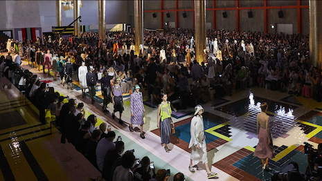 Prada, with its L'Oréal licensing deal, takes next steps to diversify product offerings to include beauty care products to support its apparel, accessories, leather goods, footwear, food and fragrance lines. Image credit: Prada