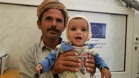 Adel with his father in the Save the Children-supported health center after he got treated for severe acute malnutrition in Yemen's Hajjah governorate. Image credit: Save the Children