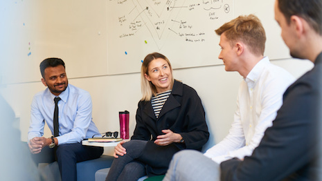 Bentley trainees interacting with managers. Image courtesy of Bentley Motors