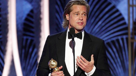"Brad Pitt in Brioni DJ accepting his Golden Globe award for his role in ""One Upon a Time in ... Hollywood."" Image credit: Brioni, Hollywood Foreign Press Association"