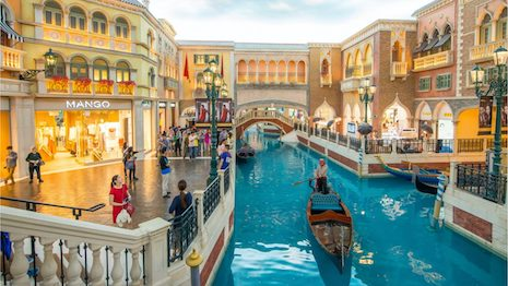 An authentic gondola floats on the Grand Canal at the Shoppes at Venetian in Macau. Image credit: Shutterstock
