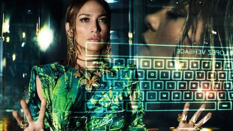Actor and entertainer Jennifer Lopez in Versace's spring summer 2020 campaign wearing that jungle dress and doing Google searches. Image courtesy of Versace