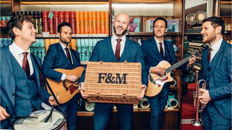 Delivery of the Fortnum's Valentine's Day Hamper comes with a serenade from the delivery guy. Image courtesy of Fortnum & Mason