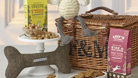 British grocer Fortnum & Mason is paying the same attention to its dog hampers as it does for its human-oriented products, including the trademark wicker basket. Image credit: Fortnum & Mason