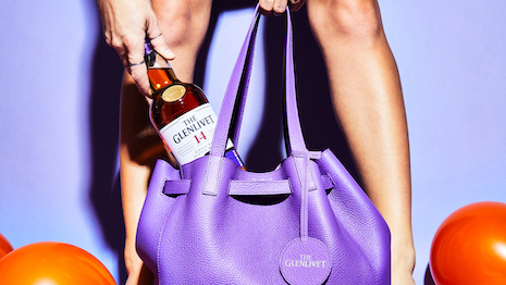 Pernod Ricard partnered with fashion label alice + olivia for a purple bucket bag inspired by The Glenlivet. Image courtesy of Pernod Ricard