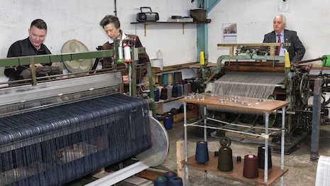 United Kingdom's Princess Anne, The Princess Royal, inspecting the making of fabric at Harris Tweed's facility in Scotland's Hebrides. Image credit: Harris Tweed