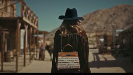 Hermès is going for entertainment value with its Kelly bag placed in an American Wild West setting, relying on house codes and its equestrian theme. Image credit: Hermès