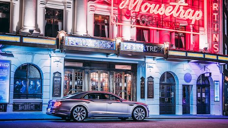 A Bentley Flying Spur outside St. Martin's Theatre in London. Image credit: Bentley Motors