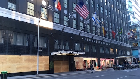 U.S. department store chain Bloomingdale's flagship store in midtown Manhattan being boarded up May 31 even as its downtown SoHo store was looted by rioters angry over police brutality toward African-Americans. Image courtesy of Mickey Alam Khan