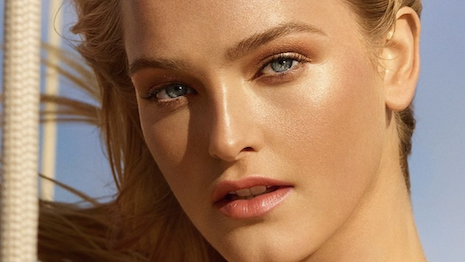 Model Jean Campbell stars in Chanel's Summer of Glow cosmetics campaign. Image credit: Chanel