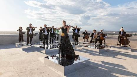 Summer Solstice performance of Antonio Vivaldi's Estate from The Four Seasons executed by the orchestra of the Accademia Nazionale di Santa Cecilia and star violinist Anna Tifu, dressed in Fendi looks. Image courtesy of Fendi