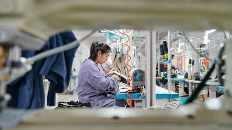 """Beijing's new guidelines address the disparity of qualities between import and export goods by reiterating """"Three Same"""" — same production line, same standard and same quality. Image credit: Xinhua News Agency"""