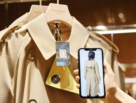 Scanning QR code on Burberry's classic trench coat in the Shenzhen, China social retail store. Image courtesy of Burberry