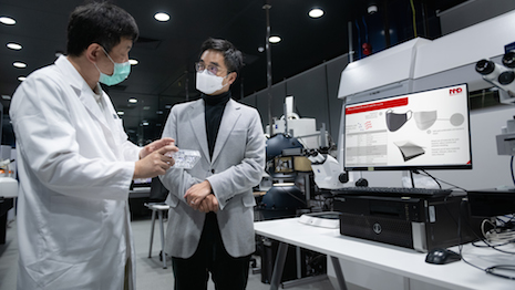 New World Development is collaborating with biomedical company Master Dynamic on the research and development of the application of NanoDiamonds technology to make the next generation of antibacterial and antiviral masks. Seen here on right, Adrian Cheng, CEO of New World Development. Image courtesy of New World Development