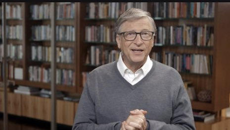 Bill Gates being interviewed, with his impressive bookcases in the background. Bookcases have become the new background accessory in the video-run COVID-19 era, reflecting both aspirations and affectations. Image credit: Bookcase Credibility