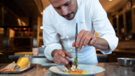 Chef Angus McIntosh prepares potato salad in Krug's Instagram Live event. Image courtesy of Krug Champagne