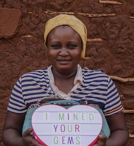 """""""I mined your gems"""" - miner Miriam. Image credit: Mines to Markets Pact"""