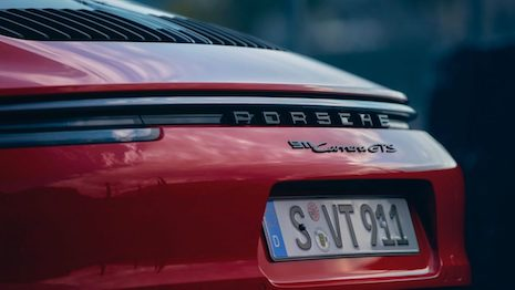 Bling is generally associated with the public display of physical luxury goods, and social media has been a game-changer where one's status can be amplified to a wider audience. Image credit: Porsche 911 GTS, courtesy of Porsche